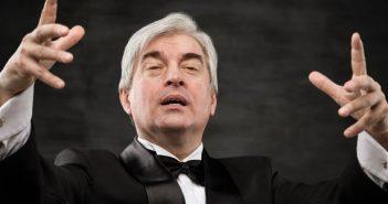 Male conductor conducting SMCR orchestra
